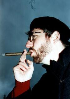 Georg Schwikart mit Zigarre